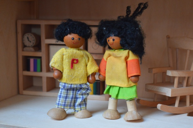 Boy and girl doll in house